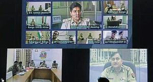 DGP OP Singh interacting with ADGs, IGs, DIGs and police chiefs through the integrated video conferencing system.(HT Photo)