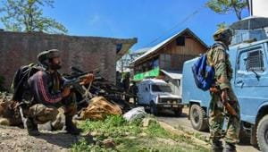 Security personnel stand guard during an encounter between security forces and militants at Drabgam in Pulwama District of South Kashmir on Monday.(PTI File photo)