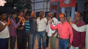 BJP workers celebrating in Jhargram after the panchayat results on Thursday.(HT Photo)