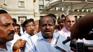 Janata Dal (Secular) leader HD Kumaraswamy (C) speaks to the media outside the legislative house after a vote of confidence motion against the BJP's BS Yeddyurappa government in Bengaluru on Saturday.(Reuters Photo)