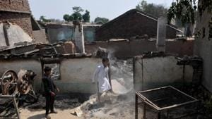 Villagers inspects the damage after their home were gutted by firing from the Pakistan side of the border in Jora farm village, in Ranbir Singh Pura district of Jammu, on Tuesday, May 22, 2018.(Nitin Kanotra / Hindustan Times)