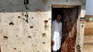 A villager inspects the damage after his home was gutted by Pakistan firing in Jora village in RS Pura district of Jammu on Tuesday.(Nitin Kanotra /HT Photo)