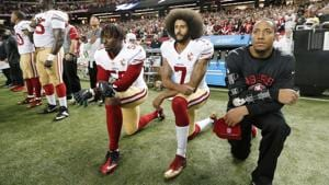 San Francisco 49ers quarterback Colin Kaepernick (centre) began kneeling for the anthem in the 2016 season to protest racism and police brutality(AP)
