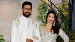 Abhishek Bachchan and wife Aishwarya Rai Bachchan pose for a picture during the wedding reception of Sonam Kapoor.(PTI)
