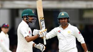 Babar Azam (L) celebrates with Sarfraz Ahmed after reaching a half century on Day 2 of the first Test between Pakistan and England at Lord's on Friday.(Action Images via Reuters)