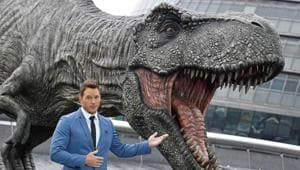 Chris Pratt poses in front of a model dinosaur during a photocall to promote the forthcoming film Jurassic World: Fallen Kingdom in London.(REUTERS)