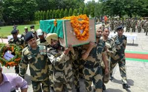 Border Security Force officers and jawans carry the coffin of Sitaram Upadhyay, who was killed in ceasefire violation by Pakistani army along the International Border, in Jammu.(PTI File Photo)