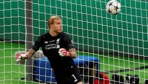 Liverpool's Loris Karius fumbles the ball as Gareth Bale scores Real Madrid's third goal in the Champions League final at the NSC Olympic Stadium in Kiev on Saturday.(Reuters)