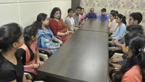 CBSE 10th result: Students of Lucknow's GD Goenka Public School interact with their principal Raveen Pande and teacher Garvita.(Deepak Gupta/HT Photo)