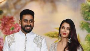Abhishek Bachchan with his wife Aishwarya Rai Bachchan pose for a picture during the wedding reception of Sonam Kapoor and businessman Anand Ahuja.(AFP)