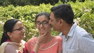 Ghaziabad's Sanya Gandhi is the joint topper in differently abled category in CBSE Class 10 exam, the results of which were declared on Tuesday. Sanya with her parents in the picture.(Sakib Ali /HT photo)
