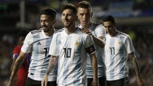 Argentina's Manuel Lanzini (L) Giovanni Lo Celso (2R), and Angel Di Maria (R) congratulate teammate Lionel Messi after his hat trick during a match between Argentina and Haiti at the Bombonera stadium in Buenos Aires, Argentina on May 29, 2018.(AP)