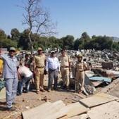 The demolition of slums underway in Vikhroli.(HT Photo)