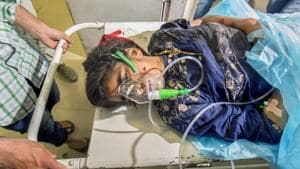 A woman injured in the Shopian grenade blast is shifted to SMHS hospital for treatment, in Srinagar.(PTI Photo)