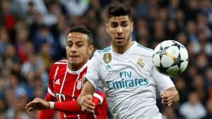 Real Madrid's Marco Asensio (in white) in action with Bayern Munich's Thiago Alcantara.(REUTERS)