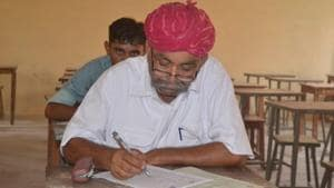 Elderly villagers appear for the class 8 examination at the Kota Open University in Barmer on Tuesday.(HT Photo)