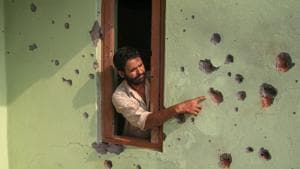 A villager shows the damaged wall of his house after shelling from the Pakistani side of the border, in the Pargwal sector of Akhnoor, on June 4, 2018.(PTI File Photo)