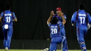 Afghanistan's Shapoor Zadran, center, celebrates after taking the first wicket of Bangladesh during the second T20 cricket match between Afghanistan and Bangladesh.(AP)
