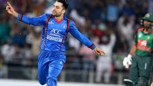 Afghan cricket player Rashid Khan (L) celebrates a wicket during the Twenty20 International cricket match between Afghanistan and Bangladesh at Rajiv Ghandi International Cricket Stadium in Dehradun.(AFP)