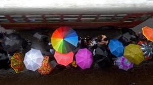 As middle-class aspirations are changing, people are spending less and less time in the rain, but spending more and more money on umbrellas.(Pratik Chorge/HT Photo)