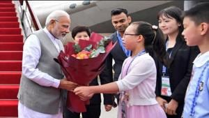 Prime Minister Narendra Modi being received in Qingdao, China on Saturday. He will be attenting the Shanghai Cooperation Organisation summit.(MEA/Twitter)