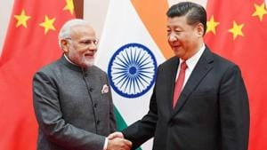 Prime Minister Narendra Modi greets Chinese President Xi Jinping during the 18th Shanghai Cooperation Organisation summit in Qingdao, China, on Saturday.(Reuters)