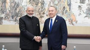 Prime Minister Narendra Modi meets Kazakhstan President Nursultan Nazarbayev on the sidelines of the Shanghai Cooperation Organisation (SCO) in Qingdao in the eastern Chinese port city on Sunday.(@MEAIndia Photo/Twitter)