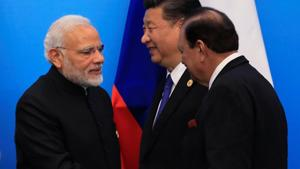Pakistan's President Mamnoon Hussain shakes hands with Prime Minister Narendra Modi as China's President Xi Jinping walks behind them at a signing ceremony during Shanghai Cooperation Organization (SCO) summit in Qingdao, Shandong Province, China on June 10.(REUTERS)