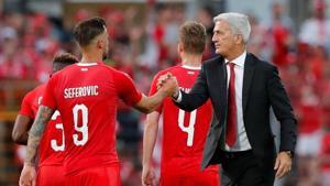 Switzerland striker Haris Seferovic shakes hands with coach Vladimir Petkovic.(REUTERS)