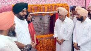 Punjab rural development minister Tript Rajinder Bajwa and MP Gurjit Singh Aujla (second from left) laying the foundation stone of a new colony in Amritsar.(HT Photo)