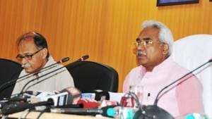Cabinet minister Madan Kaushik (right) briefs the media about cabinet decisions at secretariat in Dehradun on Wednesday.(HT Photo)