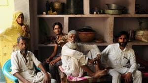 Bissar (standing) with her son her son Shakarudin (in T-shirt) and other relatives in Akeda village of (Mewa) district near Gurugram.(Parveen Kumar/ HT file photo)