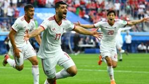 Iran's Mehdi Taremi, Majid Hosseini and Sardar Azmoun celebrate their first goal against Morocco in the FIFA World Cup 2018.(REUTERS)