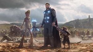 Thor returns to Earth, armed with Stormbreaker and flanked by Rocket and Groot.