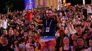 English fans at a Fan Fest celebrate their team's second goal during the FIFA World Cup 2018 match against Tunisia.(AFP)