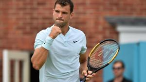 Bulgaria's Grigor Dimitrov reacts after winning a point against Bosnia and Herzegovina's Damir Dzumhur during their first round men's singles match at the ATP Queen's Club Championships.(AFP)