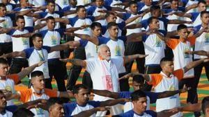 Prime Minister Narendra Modi performs yoga on International Yoga Day in Dehradun in Uttarakhand on Thursday.(Reuters)