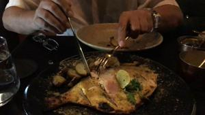 The grilled pomfret at at Karma Kismet comes with white butter sauce.(HT file)
