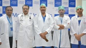 The team of doctors at Manipal hospital after the surgery.(HT PHOTO)