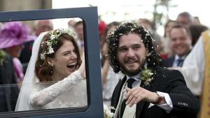 Actors Kit Harington and Rose Leslie react as they leave after their wedding ceremony at Rayne Church, Scotland on Saturday.(AP)