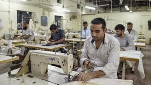 Prisoners stitch clothes in a tailoring unit in Tihar, India's most crowded prison.(Burhaan Kinu/ HT Photo)