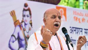 Former VHP leader Pravin Togadia addresses the public during an indefinite fast outside the state VHP headquarters in Ahmedabad recently.(PTI Photo)