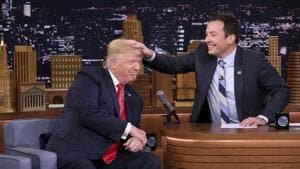 US President Donald Trump appears with host Jimmy Fallon during a taping of The Tonight Show Starring Jimmy Fallon, in New York. Fallon is opening up about the personal anguish he felt following the backlash to his now-infamous hair mussing appearance with Donald Trump. Trump opponents criticized Fallon for a cringeworthy interview only weeks before the election where Fallon playfully stroked Trump's hair.(AP)