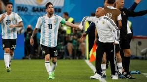 Argentina's Lionel Messi celebrates their second goal against Nigeria with coach Jorge Sampaoli at the FIFA World Cup 2018.(REUTERS)