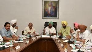 (From right) CM Capt Amarinder Singh and ministers Brahm Mohindra, Manpreet Singh Badal and OP Soni during the cabinet meeting in Chandigarh on Wednesday.(HT Photo)