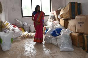 Tejaswini Galande from PCMC inspects plastic collected at one of the centres(Bachchan Kumar/HT)