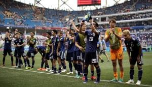 Japan advanced into the knockout phase of the FIFA World Cup on Thursday despite losing 0-1 to Poland, progressing from Group H thanks to their lower tally of yellow cards than Senegal.(REUTERS)