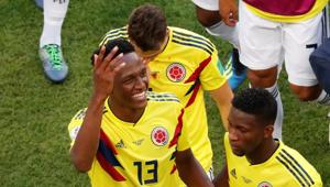 Colombia's Yerry Mina and Jefferson Lerma celebrate their win against Senegal in the FIFA World Cup at the Samara Arena on Thursday.(Reuters)