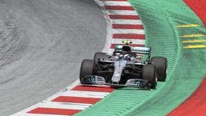 Mercedes driver Valtteri Bottas of Finland takes a curve during the qualifying session for the Austrian Formula One Grand Prix at the Red Bull Ring racetrack.(AP)