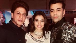 Karan Johar shared this picture with Kajol and Shah Rukh Khan from the engagement ceremony of Akash and Isha Ambani.(Instagram)
